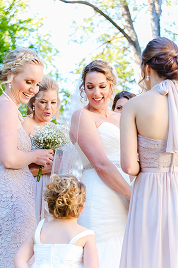 Bridesmaids gathered together laughing